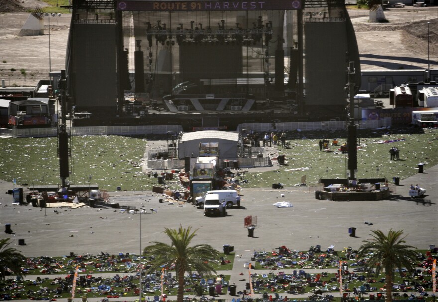 Debris is strewn through the scene of a mass shooting at a music festival near the Mandalay Bay resort and casino on the Las Vegas Strip, Monday, Oct. 2, 2017, in Las Vegas. (John Locher/AP)