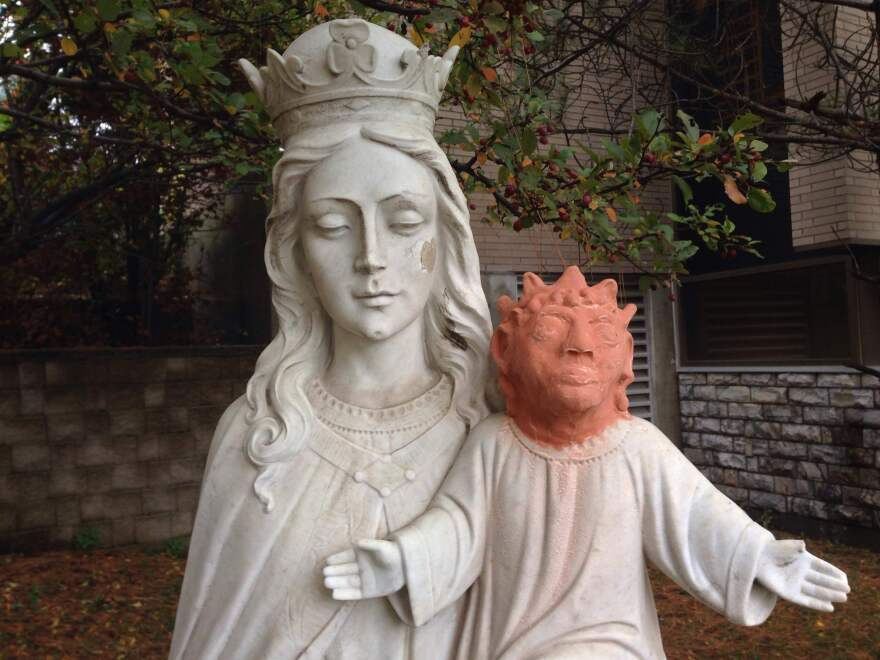This statue, in Sudbury, Ontario, was apparently vandalized about a year ago. A local artist volunteered to help replace Jesus' missing head, but not everyone appreciates her efforts.