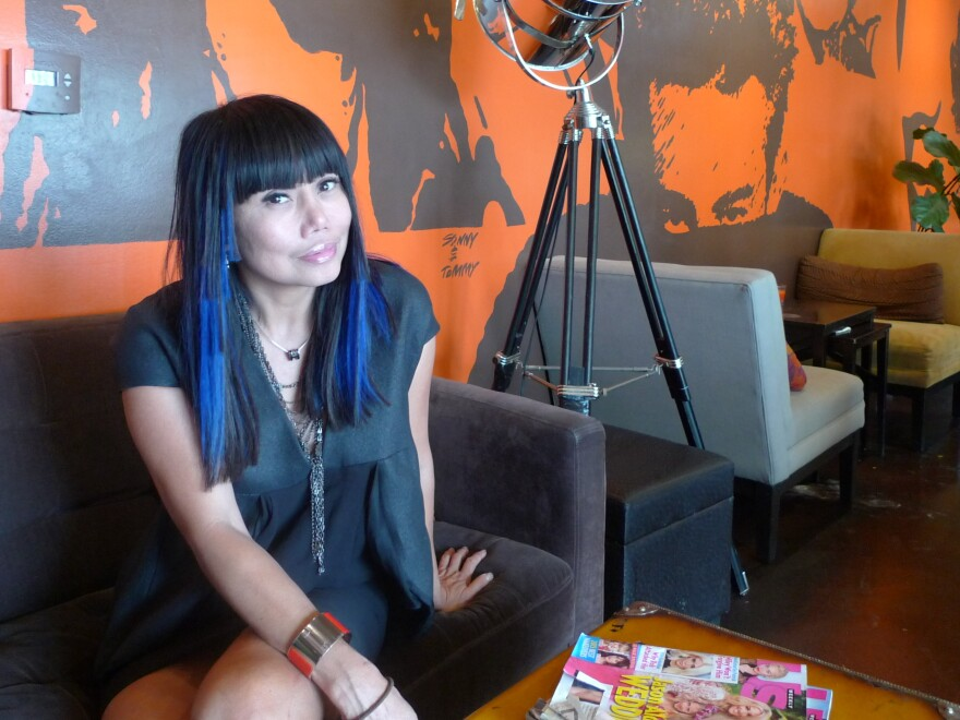 Lynda Trang Dai sits inside her restaurant, Lynda Sandwich, in Orange County, Calif.