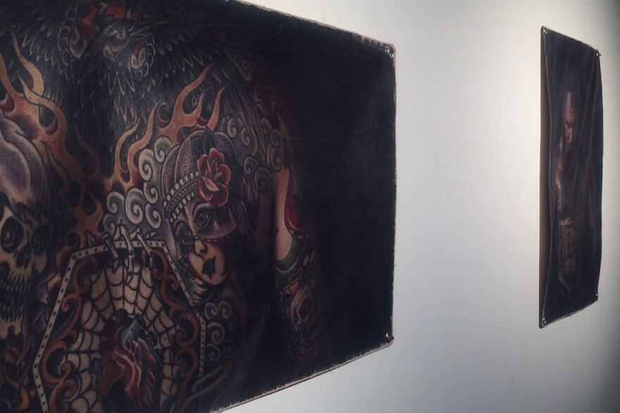 Brain Cummings' printed his photos on leather to mimic the application of ink to human skin.