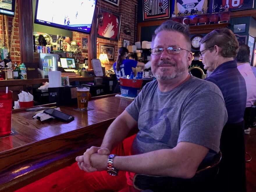Man sits at a bar.