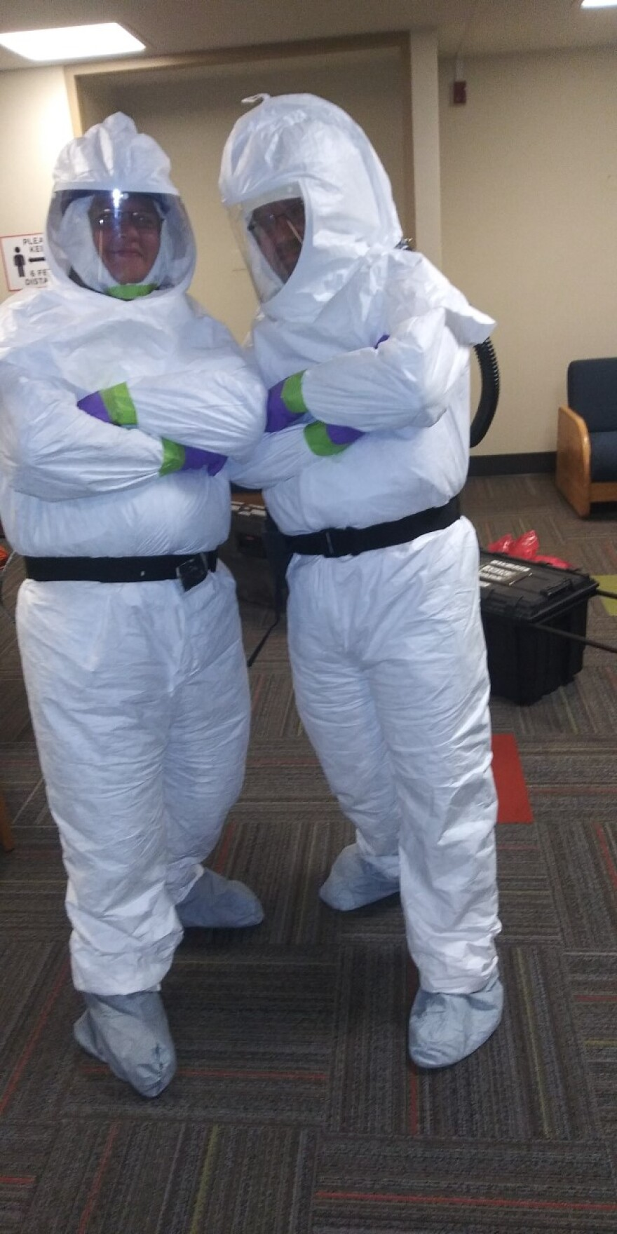 a photo of custodial staff in PAPR suits