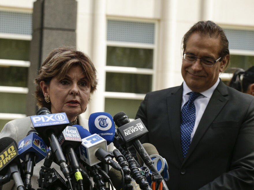 Gloria Allred, left, who is representing some of Kelly's alleged victims, addresses the news media outside of the courthouse on Aug. 2 in New York. To her right is David Anton, one of Kelly's defense attorneys.