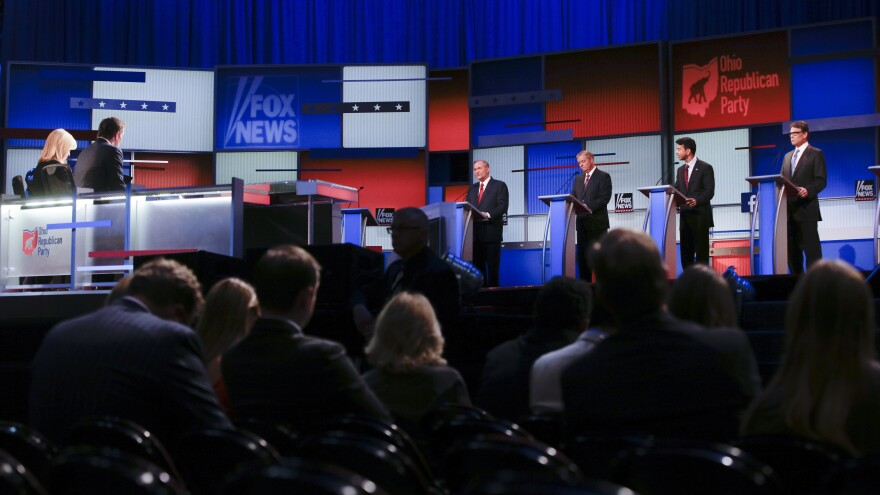 Republican presidential candidates Jim Gilmore, Lindsey Graham, Bobby Jindal and Rick Perry participate in a pre-debate forum Aug. 6 in Cleveland. The event gave airtime to seven candidates whose polling numbers were below a top-ten cutoff Fox News set to participate in the main debate.