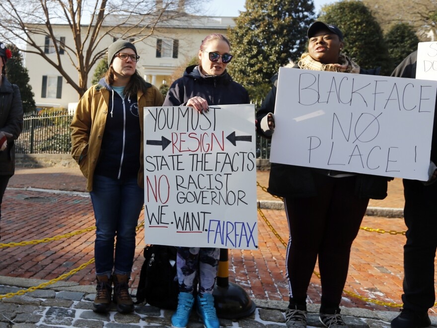 Demonstrators hold signs and chant in Richmond, Va., on Feb. 2. They were calling for the resignation of Gov. Ralph Northam after a racist photo on his medical school yearbook page came to light. He denies that he is in the photo but admits to once dressing in blackface.