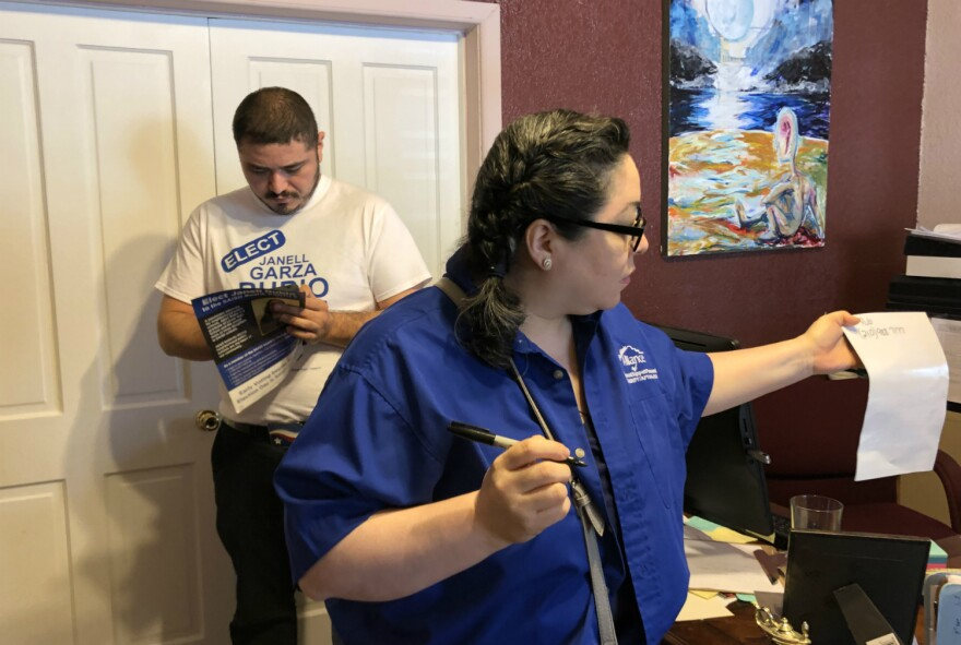 Teacher union members write down Janell Rubio's phone number to pass onto voters before handing out to campaign for the district 5 challenger Apr. 13.