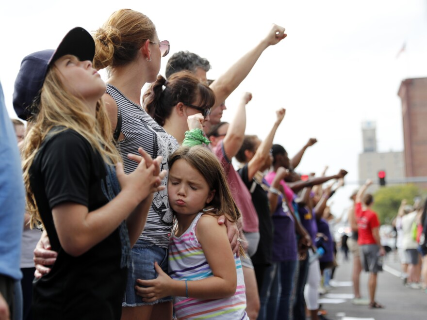 Demonstrations have taken to the streets every day since a white former St. Louis police officer was acquitted Friday in the 2011 killing of a black man. On Saturday, protesters stood silently outside the St. Louis Police Department headquarters.