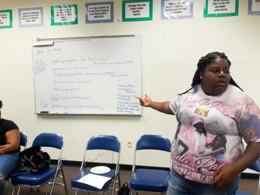 Valencia Gunder gives teenager an overview of organizing and advocating for a cause.