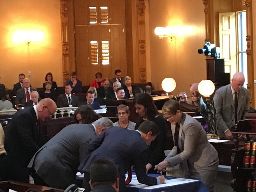 photo of electors signing in