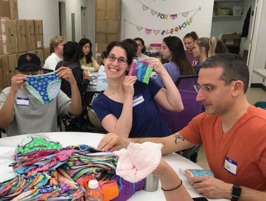 Volunteers pack underwear for schools