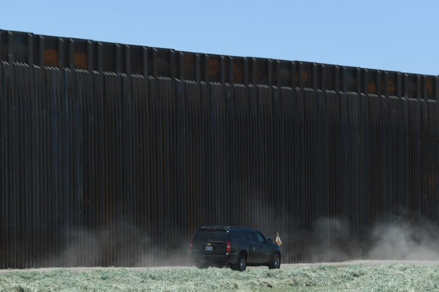 A car with President Trump drives after participating in a ceremony commemorating the 200th mile of border wall at the international border with Mexico in San Luis, Ariz., on June 23.