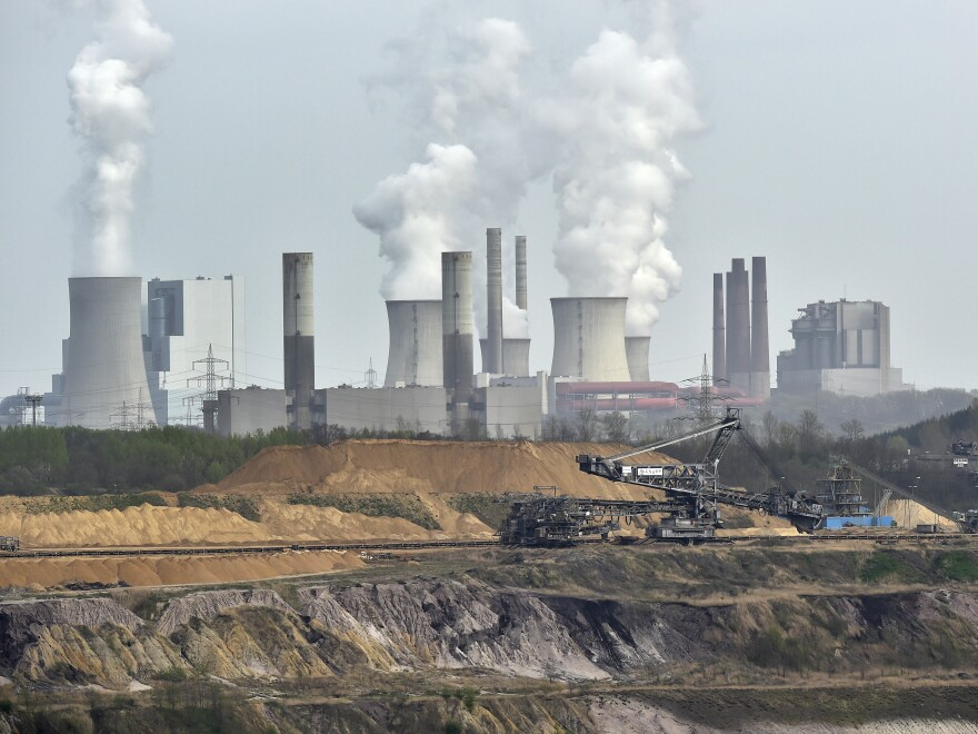 The Garzweiler coal mine and power plant near the city of Grevenbroich in western Germany. Plans to expand an open-pit brown coal mine in the eastern German village of Pödelwitz have prompted protests.