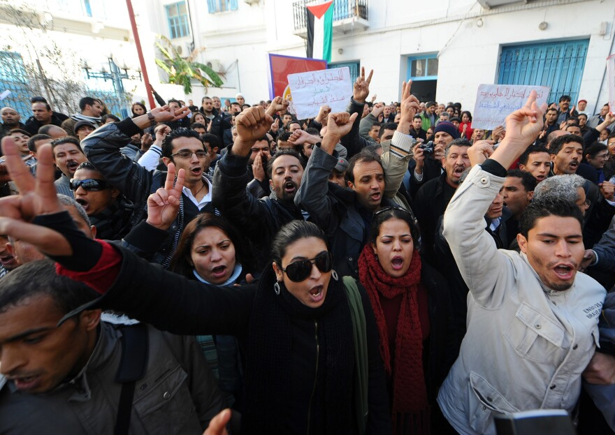 People shout slogans in solidarity with residents of Sidi Bouzid during a demonstration on Dec. 27, 2010, in Tunis. The Arab Spring began that month in Tunisia, following the self-immolation of a Sidi Bouzid street vendor. Riots and demonstrations followed against unemployment and poor living conditions.