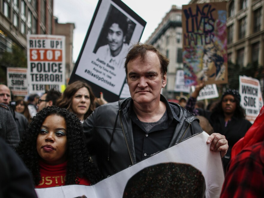 "Director Quentin Tarantino attends a march to denounce police brutality in New York City on Oct. 24. At the rally, Tarantino said, ""I have to call the murdered the murdered, and I have to call the murderers the murderers"" — drawing considerable backlash from police unions."