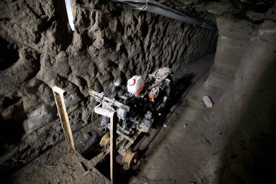"""A motorcycle adapted to a rail sits in the tunnel under the house where, according to authorities, drug lord Joaquín """"El Chapo"""" Guzmán made his escape from the Altiplano maximum-security prison."""