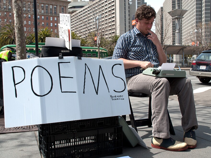Poet-for-hire Zach Houston works at the Ferry Plaza Farmers Market in San Francisco. Houston says he is paid about $2 to $20 for each poem.