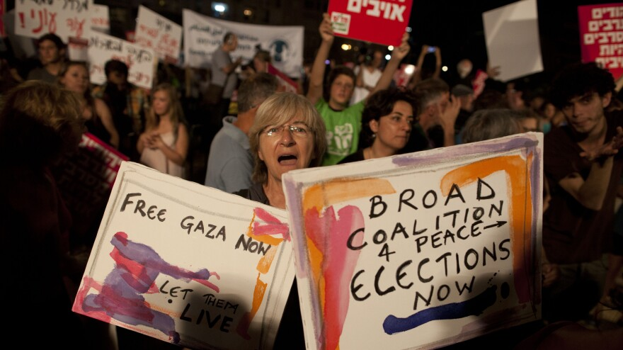 Israelis in Tel Aviv take part in a protest against the military operation in the Gaza Strip on July 26. Israel's permissive approach to free speech has long fostered protests like these, but some Israelis now say that dissenters are traitors.