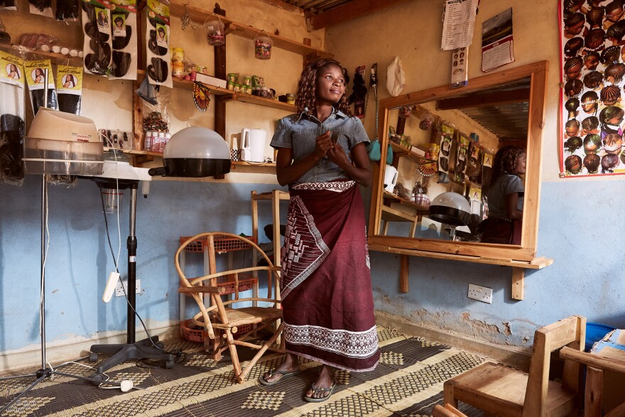 Chrissy Masala in her hairdressing salon in Mpyupyu, Malawi. For five years, Masala says she would have sex with fisherman and be paid with fish, which she would sell at local markets and big cities. But she felt that the community disapproved. Eventually, she saved enough money to open the salon in 2013.