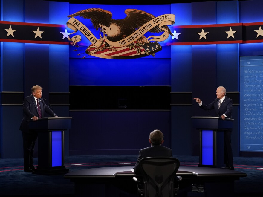 President Trump and Democratic presidential candidate Joe Biden participate in Tuesday's chaotic presidential debate with moderator Chris Wallace of Fox News.