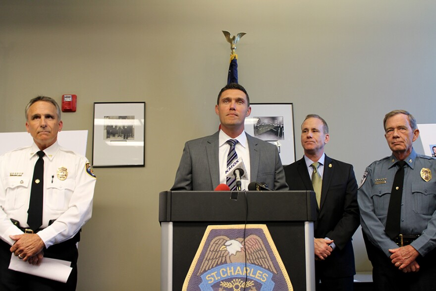 St. Charles County Prosecutor Tim Lohmar announces charges for more than 50 people for trafficking heroin on June 10, 2015.