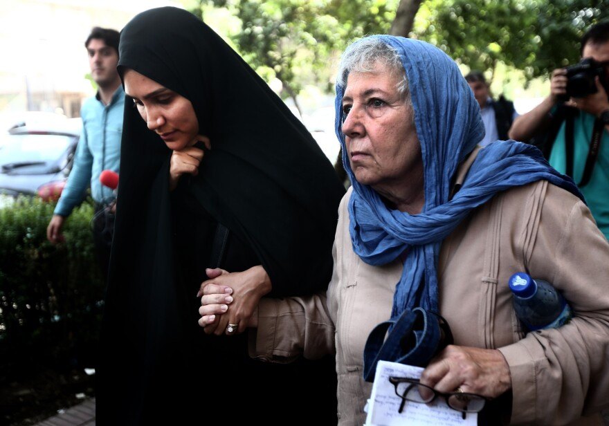 Mary Rezaian (right), the mother of detained <em>Washington Post</em> correspondent Jason Rezaian and his wife, Yeganeh Salehi (left), leave the Revolutionary Court after a hearing on Aug. 10, 2015, in Tehran. Rezaian is set to be released Saturday, as part of a prisoner exchange between Iran and the U.S.