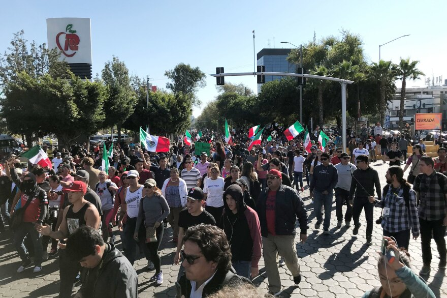 A few hundred people gathered in Tijuana's high-end Rio area on Sunday to protest against groups migrating from Central American countries.