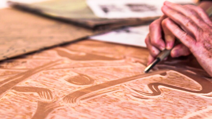 Polly Perkins, a St. Petersburg, FL based artist, demonstrates how to carve a woodblock using an ancient Japanese tool. Thomas Iacobucci/WUSF Public Media