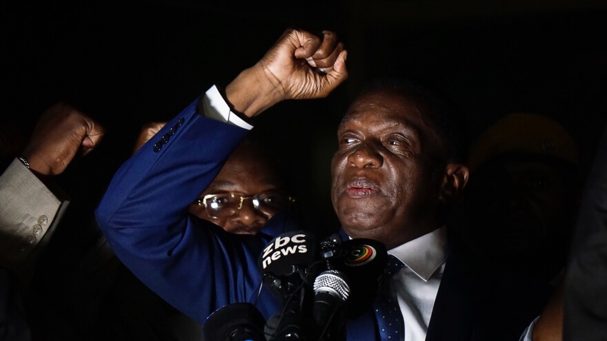 Zimbabwe's incoming president Emmerson Mnangagwa gestures as he speaks at Zimbabwe's ruling ZANU-PF party headquarters in Harare, Zimbabwe, on Wednesday. The former vice president flew home from a short exile to take power after the resignation of Robert Mugabe put an end to 37 years of authoritarian rule.