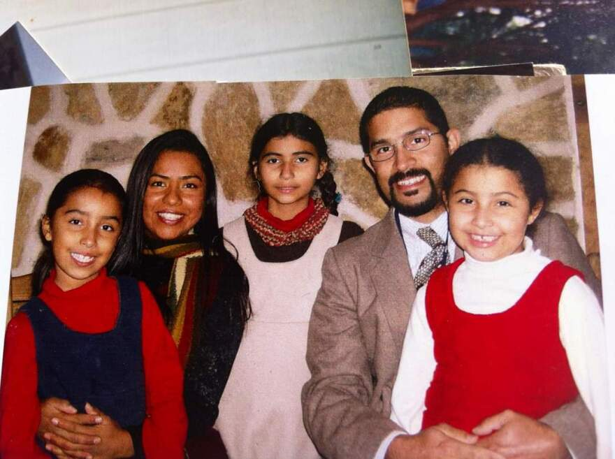 A family photo of Karina and Hipolito Mojica and their three daughters. The family has lived apart split by the Texas-Mexico border and U.S. immigration law.
