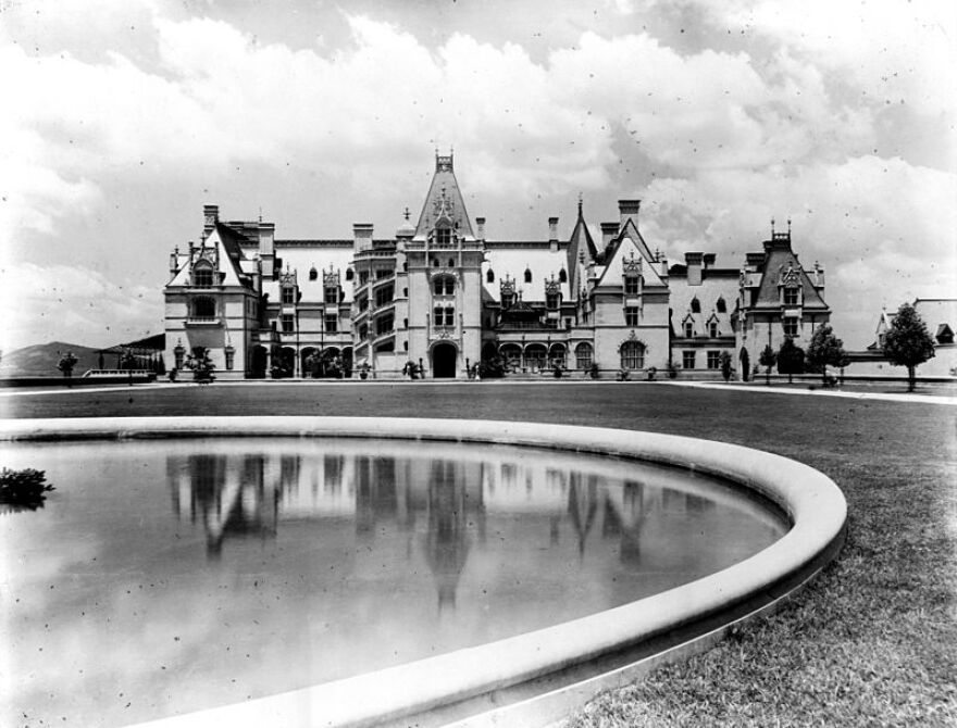 Photo of the Biltmore House with reflecting pool in the Biltmore gardens Esplanade.