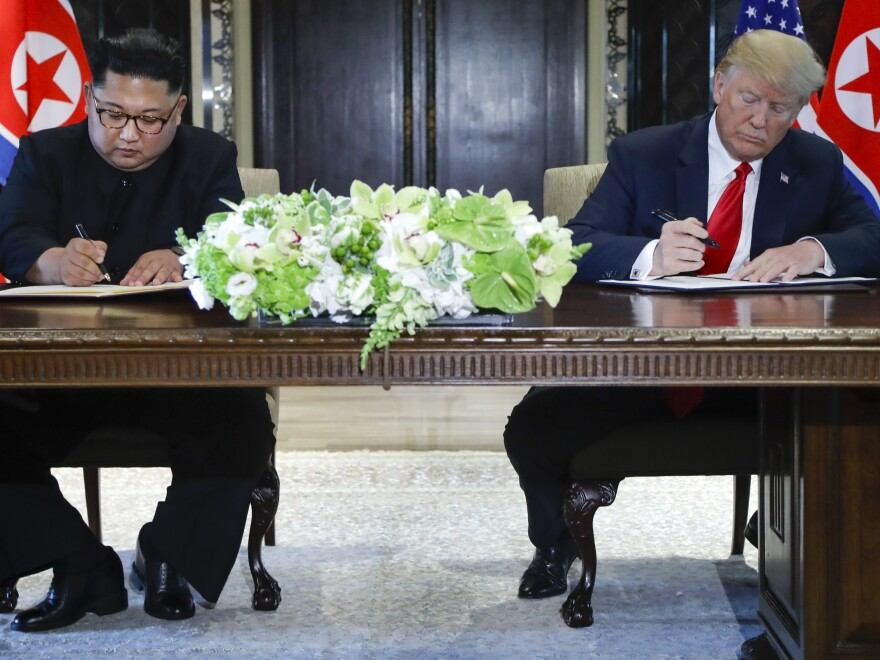 Kim Jong Un and President Trump at the signing ceremony after their meetings in Singapore.