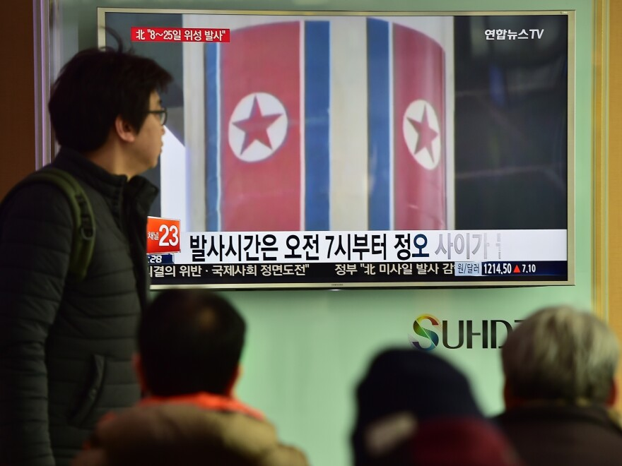 People watch a news report at a railway station in Seoul on Feb. 3. North Korea launched a long-range rocket Sunday local time, defying international criticism.