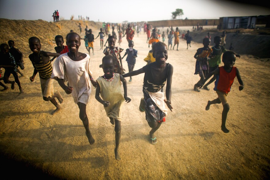 Kids find a moment of joy at the U.N. camp near the ruined town of Bentiu.