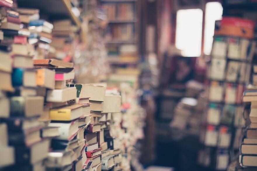 books_in_big_piles.jpg