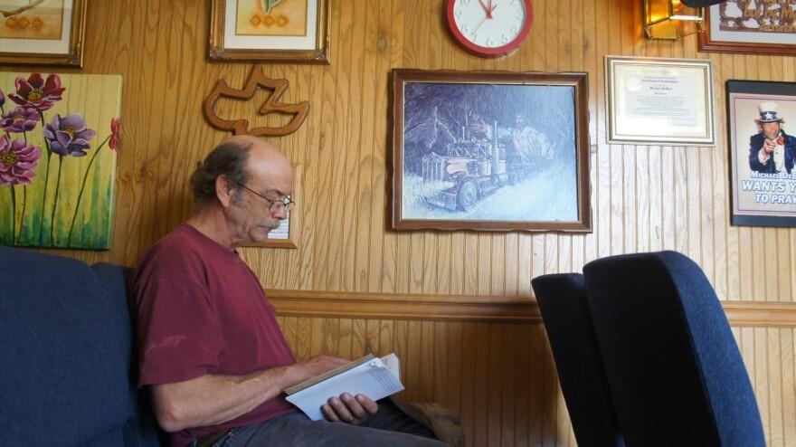 A driver sits during the chapel service. (Saul Gonzalez/KCRW)