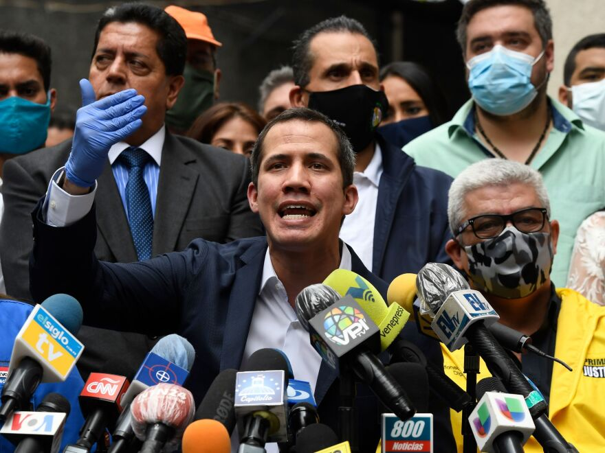 Venezuelan opposition leader and self-proclaimed acting president Juan Guaidó delivers a press conference at Democratic Action party headquarters in Caracas on June 17.