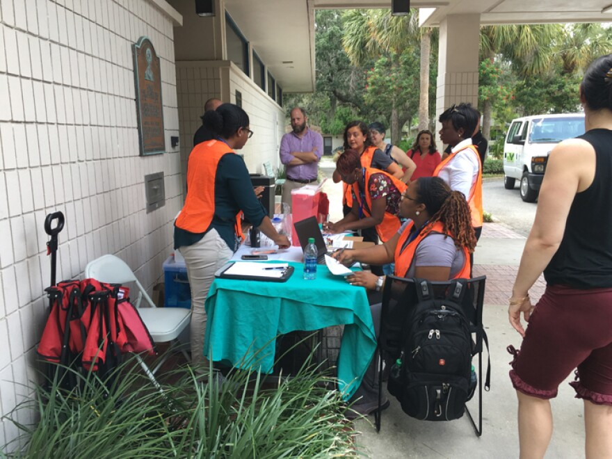 Members of the health department provide free hepatitis A vaccinations in front of the Gulfport Library.