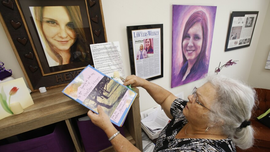 Susan Bro, mother of Heather Heyer, who was killed during the Unite the Right rally in August 2017, looks over memorabilia in her office in Charlottesville, Va., a year later.