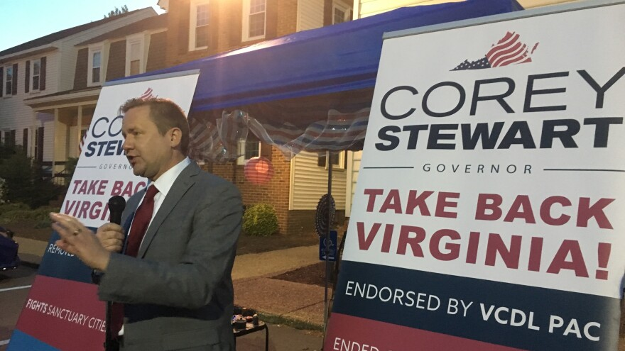 """Corey Stewart, seen at a campaign rally in Virginia Beach, Va., is appealing to supporters of President Trump on the campaign trail. """"Who's excited that we finally have a real president of the United States?"""" he recently asked."""