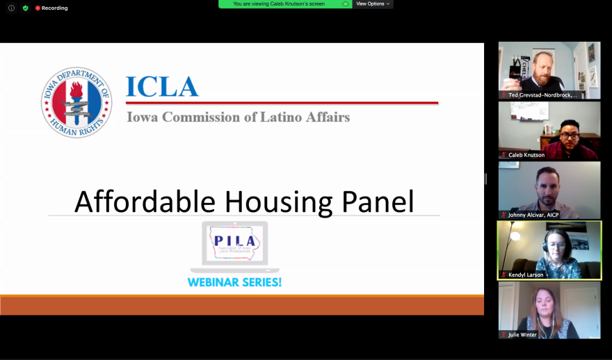 """A screenshare on Zoom shows a PowerPoint slide that says """"ICLA: Iowa Commission of Latino Affairs"""" and """"Affordable Housing Panel Webinar Series."""" Five people appear in windows on the right side."""