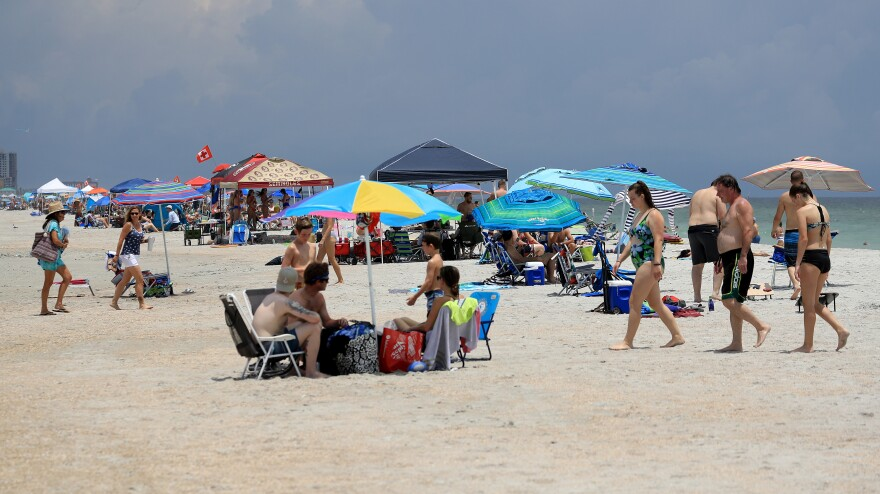 People visit Jacksonville Beach, Florida, on the Fourth of July holiday. Coronavirus cases are spiking in states such as Florida, Texas and Arizona.