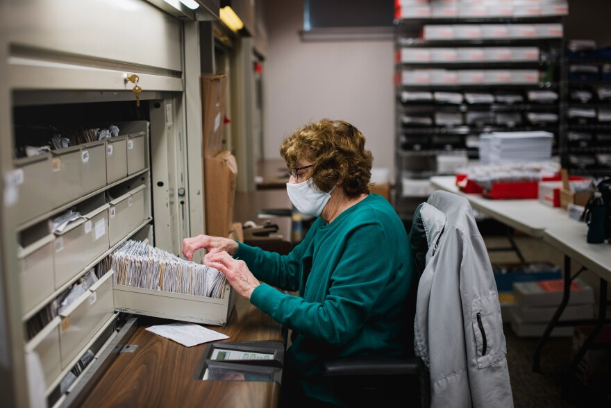 Ellen Ortt looks through old voter registration files at the Voter Registration office in the Lehigh County Government Center in Allentown, Pa. Ortt is looking to see which files need to be update with a new address or a party switch.