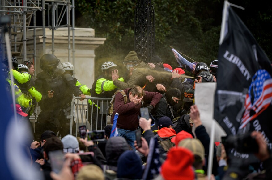 210106 Pro-Trump supporters and police clash outside the United States Capitol Building during a March to Save America Rally on January 6, 2021 in Washington, DC, USA. Photo: Joel Marklund