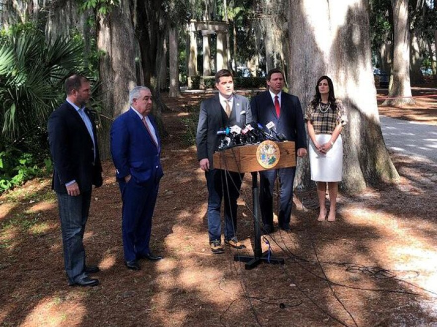 Matt Goetz (middle) introduces John Morgan (on left) during a press conference announcing changes to the handling of the smoking ban on medical marijuana. Gov. Ron DeSantis (on right) said he would like to see lawmakers make changes.