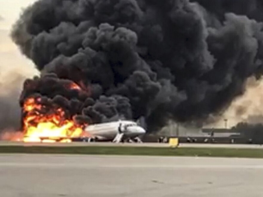 A video still shows a Sukhoi Superjet 100 aircraft on fire after a hard landing Sunday at Moscow's Sheremetyevo airport. At least 41 people on Aeroflot Flight 1492 died.