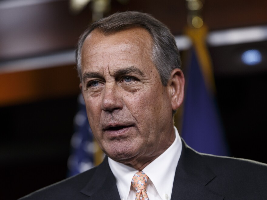 Speaker of the House John Boehner responds to reporters about the impasse over passing the Homeland Security budget on Friday.