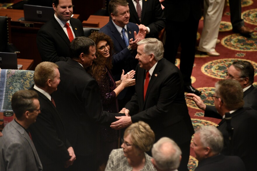 Gov. Mike Parson greets members of the Missouri Legislature ahead of his 2020 State of the State address.