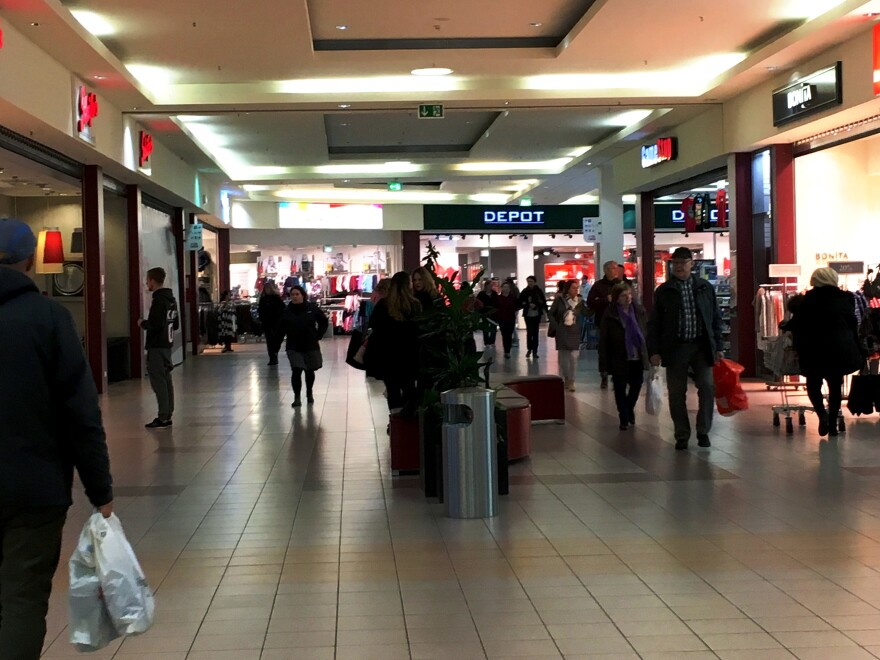 Residents of Salzigitter shop at the local mall. Officials say their community and its resources are being overwhelmed by refugees, most of them from Syria.