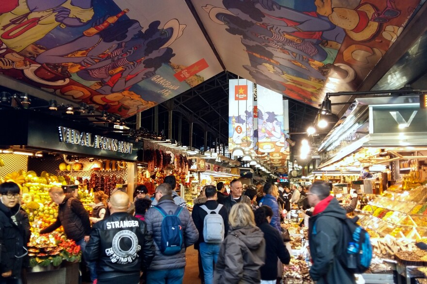 After vendors complained of over-crowding, Barcelona's City Hall now limits the number of tour groups allowed to enter the centuries-old La Boquería market.