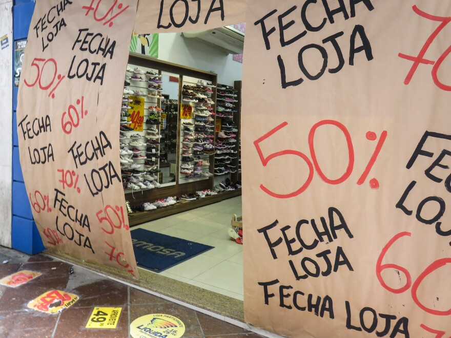 Amid Brazil's worst recession on record, shops like this one in Porto Alegre are holding final sales before they close.
